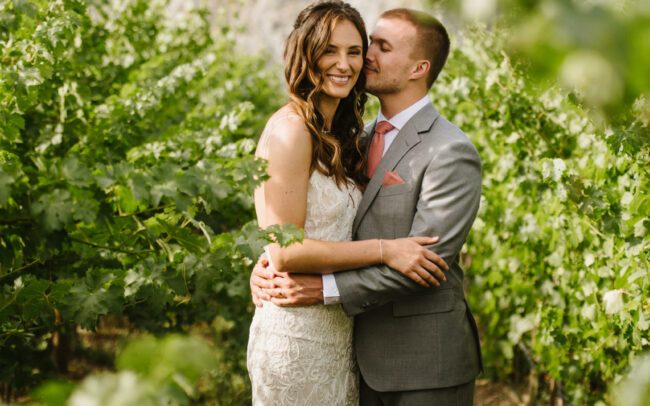 Bride and groom in a fruit orchard