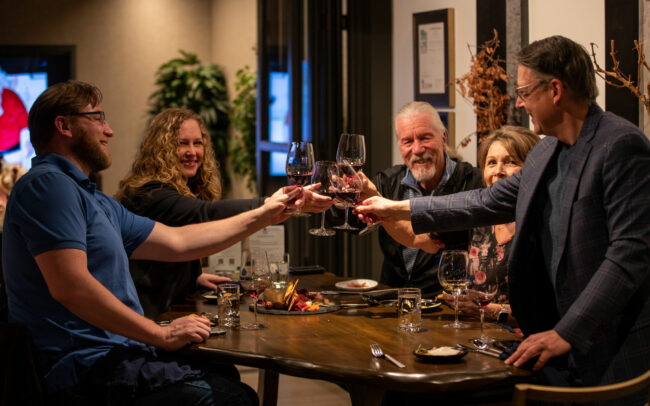 Guests toasting in tasting room